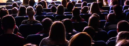 People in the auditorium watching the performance. The audience in the theater royalty free stock photos