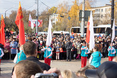 People await the arrival of the Olympic flame Royalty Free Stock Photo