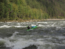 People are awesome - kayak trip down the river in wilderness Royalty Free Stock Images