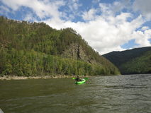 People are awesome - kayak trip down the river in wilderness Stock Images