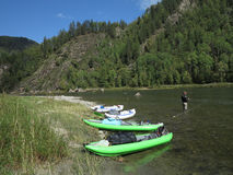 People are awesome - kayak trip down the river in wilderness Royalty Free Stock Image