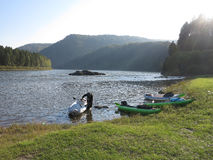 People are awesome - kayak trip down the river in wilderness Stock Photo
