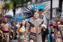 People in aztec costumes marching stock images