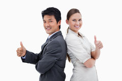 People back to back with the thumb up Stock Images