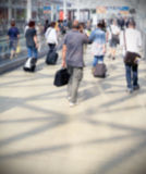 People background. Intentionally blurred background, commuters leave the station Stock Photos