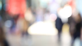 People background, intentionally blurred post production. People walk visiting Salone del Mobile, international trade show of design and furniture in Milano stock footage