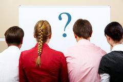 People backs. Rear view of business team with whiteboard in front of them royalty free stock photography
