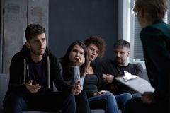People with bad habits. Worried young people with bad habits on group psychotherapy Stock Photos