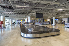 People at baggage belt inside the new terminal at airport of Mar Royalty Free Stock Image