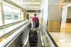 People with baggage on a moving staircase Royalty Free Stock Photos