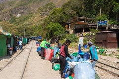 People and baggages on railway track to Machu Picchu, Peru. Hydroelectric Station, Peru - September 8, 2015: Food stalls, peruvian people and tourists at Stock Photo