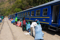 People and baggages on railway track to Machu Picchu, Peru. Hydroelectric Station, Peru - September 8, 2015: Food stalls, peruvian people and tourists at Stock Photos