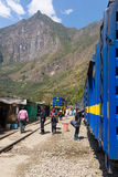 People and baggages on railway track to Machu Picchu, Peru. Hydroelectric Station, Peru - September 8, 2015: Food stalls, peruvian people and tourists at Royalty Free Stock Photo