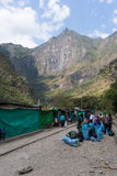 People and baggages on railway track to Machu Picchu, Peru. Hydroelectric Station, Peru - September 8, 2015: Food stalls, peruvian people and tourists at Royalty Free Stock Image