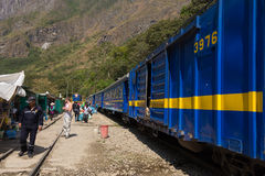 People and baggages on railway track to Machu Picchu, Peru Royalty Free Stock Image
