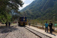 People and baggages on railway track to Machu Picchu, Peru. Hydroelectric Station, Peru - September 8, 2015: Food stalls, peruvian people and tourists at Stock Image