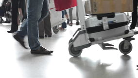 People with baggages walking at airport stock footage