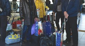 People with bags for traveling. At the station Royalty Free Stock Photos