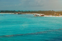People on bahamas beach. Aerial view. People vacation on carribean island royalty free stock photos