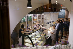 People in the bakery of Philip Volchek Stock Photography