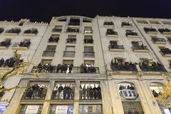 People on the balconies of one of the buildings in the Plaza de. Alcoy, Spain. January 5, 2018: People on the balconies of one of the buildings in the Plaza de Royalty Free Stock Photography