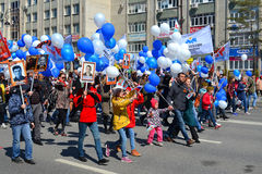 People with balloons and flags participate in demonstration in h Stock Photos