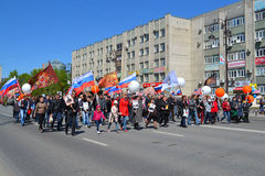 People with balloons and flags participate in demonstration in h. Onor of a Victory Day on May 9, 2016. Tyumen, Russia Stock Photo