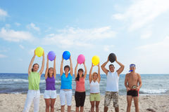 People with balloons in many colors Royalty Free Stock Images