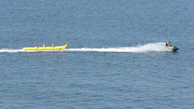 People on a banana at the sea. Three people are riding on inflatable bananas at the Black sea near Sozopol, Bulgaria stock footage