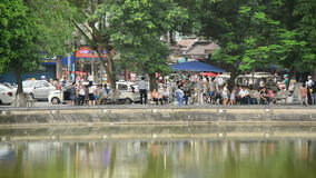People on the Banks of Hoan Kiem Lake - Hanoi Vietnam stock video footage