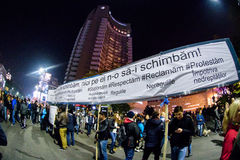 People with banner at Bucharest 2015 demonstration Royalty Free Stock Image