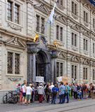 People with banners at the entrance to the Zurich Town Hall Stock Images