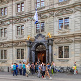 People with banners at the entrance to the Zurich Town Hall Royalty Free Stock Photography