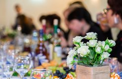 The people at the Banquet. A solemn event in the enterprise. Anniversary or wedding. Snacks and alcohol on the tables Stock Photography
