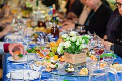 The people at the Banquet. A solemn event in the enterprise. Anniversary or wedding. Snacks and alcohol on the tables Royalty Free Stock Photo