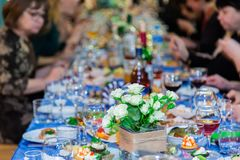 The people at the Banquet. A solemn event in the enterprise. Anniversary or wedding. Snacks and alcohol on the tables. Served buffet style. Catering Stock Photo