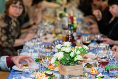 The people at the Banquet. A solemn event in the enterprise. Anniversary or wedding. Snacks and alcohol on the tables Stock Photo