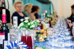 The people at the Banquet. A solemn event in the enterprise. Anniversary or wedding. Snacks and alcohol on the tables Royalty Free Stock Images