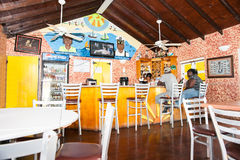 People at bar on tropical island Royalty Free Stock Image