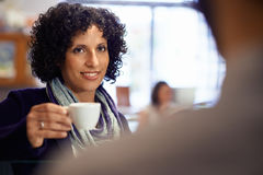 People in bar with woman drinking espresso coffee Stock Image