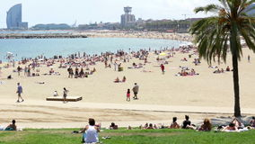 People  at Barceloneta beach in Barcelona stock video footage