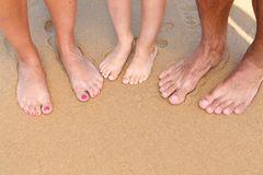 People barefoot on the sand Royalty Free Stock Photo