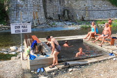 People in basins with thermal water. Near Cerna river,Baile Herculane,Romania Stock Photo