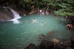 People bath in Erawan waterfall Stock Image