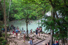 People bath in Erawan waterfall Stock Photos