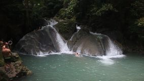 People bath in Erawan waterfall stock video