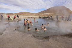 People bathe in geyser thermal water, Chile. Stock Photography