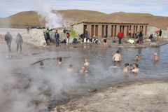 People bathe in geyser thermal water, Chile. Stock Photo