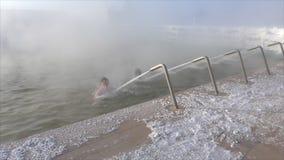 People bathe in hot springs stock video footage