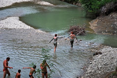 People bathe in the mountain river after acceptance of mud baths in Krasnodar Krai. Stock Images